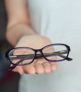 woman hold glasses in hands close up.